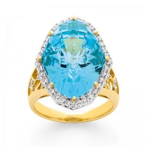 Bague Topaze bleue 14,9 Carats et Diamants 0,51 Carat H SI Or jaune